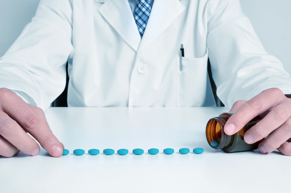 pharmaceutical scientist with a pill of blue pills