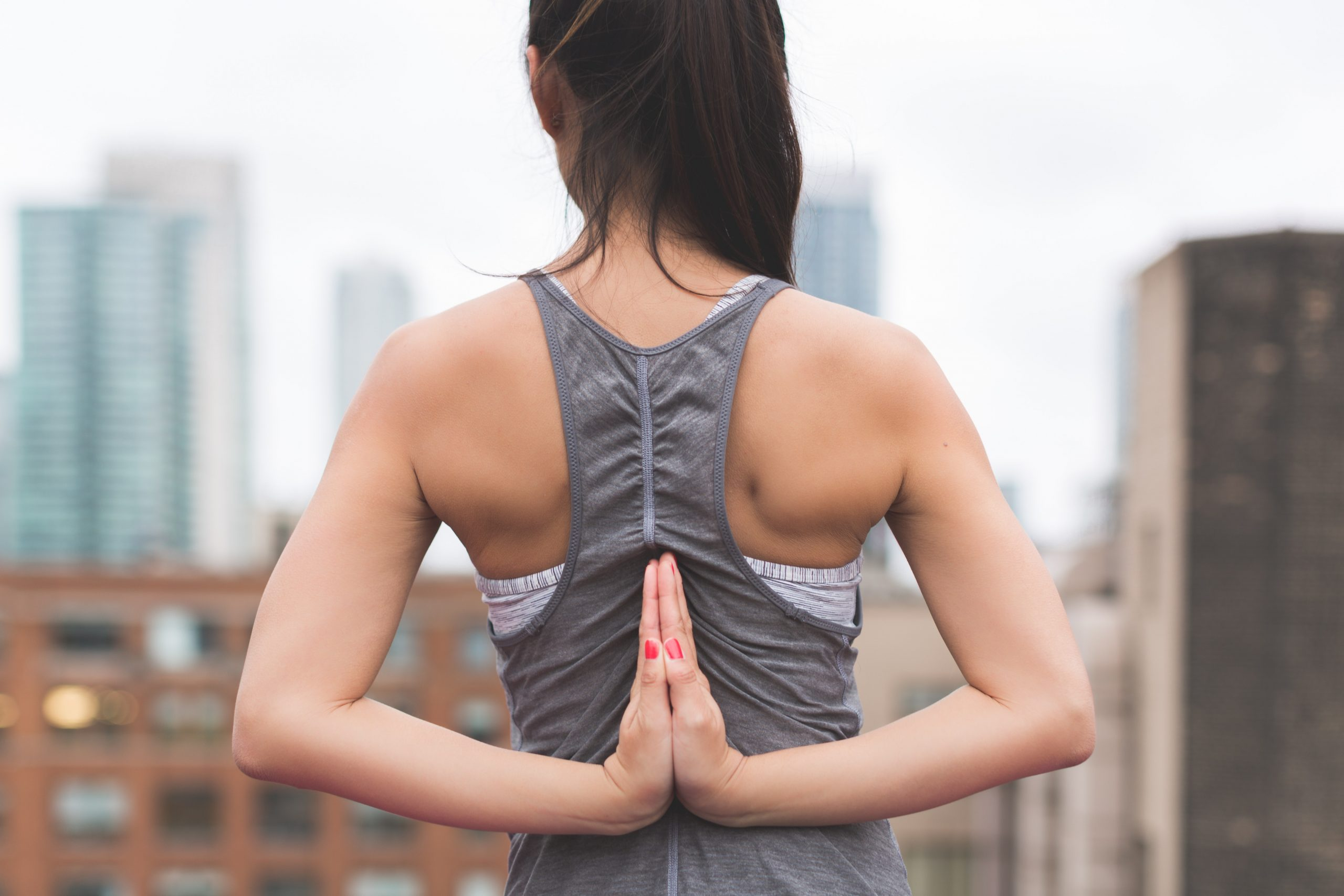 brown haired women practising yoga for world mental heath day