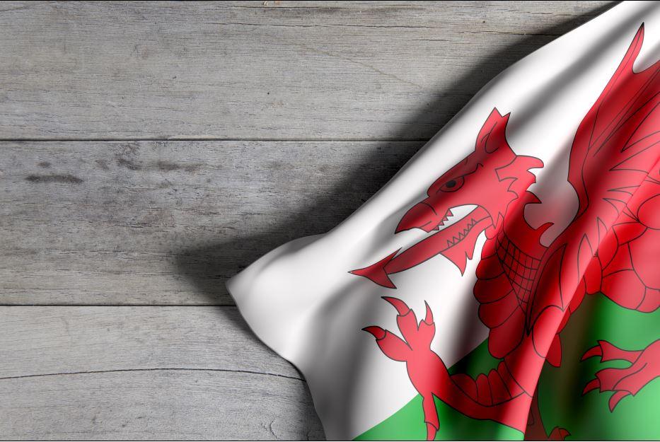 Wales flag on wood floor