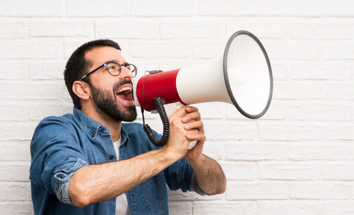 Man houting through megaphone