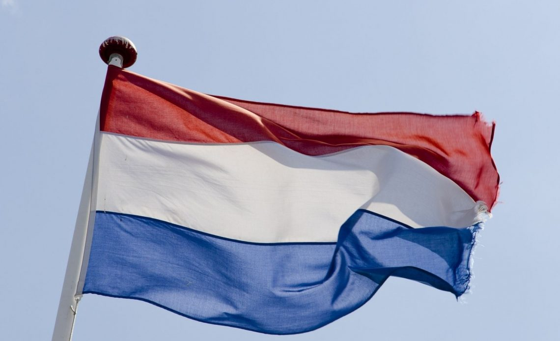 A Dutch flag flapping in the air with a slightly tattered edge celebrating the flavour ban being delayed