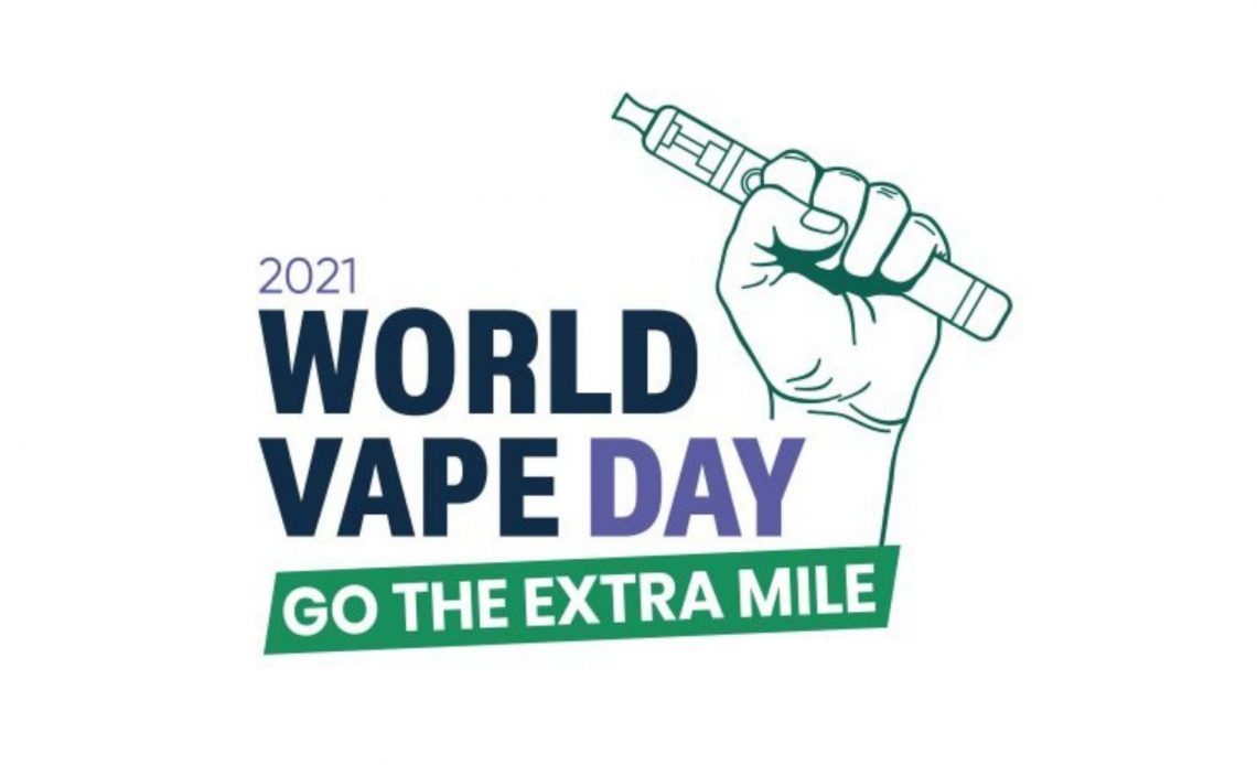 A white and green logo for world vape day featuring a hand holding a vape aloft